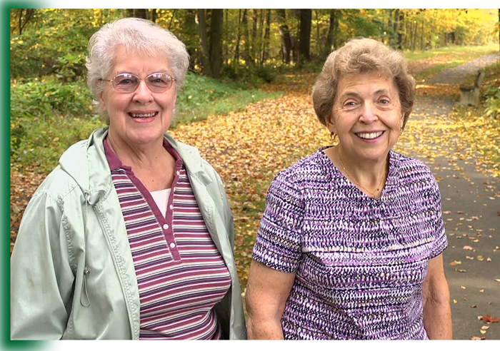 Two ladies walking on wooded trail at Laurel View Village, Davidsville, PA near Johnstown and Somerset PA