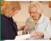 CHA Aide helps Resident with Meds at Laurel View Village