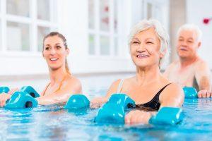 Seniors doing water aerobics